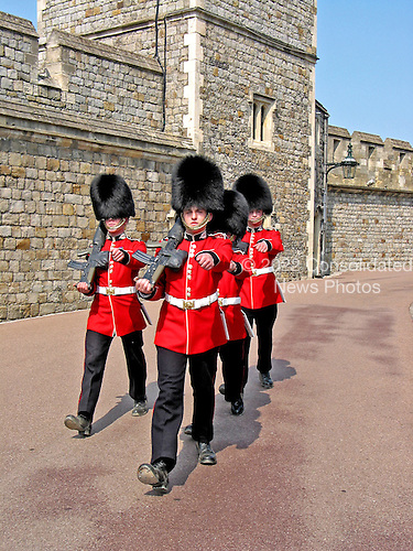 Windsor, England, GBR - August 10, 2003 -- Guards return to their barracks after the changing of the guard at Windsor Castle in Windsor, Sunday, August 10, 2003.  Queen Elizabeth II makes  the castle her primary residence during most of the year.  It is used as a venue for state visits..Credit: Ron Sachs / CNP