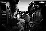 """Mumbai, the city symbolic of the Indian miracle and its sustained economic growth, will become, in 2020, the most populopus metropolis of the world. Today more than 40% of its inhabitants lives in the various slums and shantytowns that define the urban landscape of this Indian """"megacity""""Among the slums, the best known is Dharavi, thanks also to the international success of the Slumdog Millionaire movie. The main street of Dharavi, May 10, 2007  Dharavi is a shantytown with one of the highest demographic densities of the world, also known as the largest in Asia..."""
