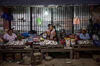 Vendors wait for customers in a Sunday market at night, in Eterazama town, Chapare region, Bolivia. December 01, 2019.<br /> Des vendeurs attendent les clients dans un marché le dimanche soir, dans la ville d'Eterazama, région du Chapare, Bolivie. 01 décembre 2019.