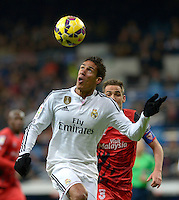 MADRID - ESPAÑA - 04-2-2015: Varane (Izq.) jugador de Real Madrid, disputa el balon con Fernando Navarro (Der.) jugador del Sevilla durante partido de La Liga de BBVA de España, 2015 Real Madrid  y Sevilla en el estadio Santiago Bernabeu de la ciudad de Madrid.  / Varane (L) player of Real Madrid vies for the ball with Fernando Navarro (R) player of Sevilla, during a match between Real Madrid and Sevilla for the La Liga de BBVA de España 2015 in the Santiago Bernabeu stadium in Madrid.  Photo: Asnerp / Patricio Realpe / VizzorImage.