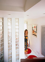 Fiona Stuart caught in motion walks along a corridor in her home