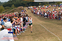 With a crowd lined up along the long finish stretch, Rock Bridge senior Evan Schulte pushes to the finish en route to a 26-second victory at the 2013 Parkway West Cross Country Invitational.