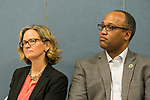 Wyandanch, New York, USA. March 26, 2017. L-R, LAURA CURRAN, Nassau County Legislator (Dem - District 5), and DuWAYNE GREGORY, Presiding Officer and Suffolk County Legislator (Dem - District 15), listen to fellow speakers at Politics 101 event, the first of series of activist training workshops for members of TWW Long Island, the L.I. affiliate of national Together We Will. Curran is a Democratic candidate for Nassau County Executive. One of the 5 speakers referred to groups such as TWWLI as activist pop-up groups.