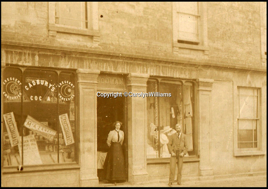 BNPS.co.uk (01202 558833)<br /> Pic: CarolynWilliams/BNPS<br /> <br /> Charles Bodman's father outside the shop in 1900.<br /> <br /> Poignant time capsule trunk from the Great War rediscovered...<br /> <br /> An incredible 'time capsule' trunk containing the personal effects of a tragic World War One officer that his grieving family shut away in 1918 has been unearthed - almost 100 years later.<br /> <br /> The military items belonged to Second Lieutenant Charles Bodman, from Marshfield, Glos, who was killed three months before the end of the war in 1918.<br /> <br /> After his death all his possessions, including his uniforms, caps, brass badges, detailed trench maps, orders, handbooks, photographs, German souveniers, letters, water bottles, lanyard and even spent bullets, were sent back to his widowed mother Sarah who locked them away in the trunk.