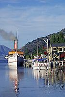 The STEAMSHIP EARNSLAW takes tourists on scenic cruises of LAKE WAKATIPU, and docks in QUEENSTOWN - SOUTH ISLAND, NEW ZEALAND