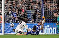 Adrien Rabiot of Paris Saint-Germain opens the scoring with his goal past Cesar Azpilicueta of Chelsea & Goalkeeper Thibaut Courtois of Chelsea during the UEFA Champions League Round of 16 2nd leg match between Chelsea and PSG at Stamford Bridge, London, England on 9 March 2016. Photo by Andy Rowland.