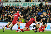 Ospreys' Dan Biggar is tackled by Scarlets' Jake Ball<br /> <br /> Photographer Ashley Crowden/CameraSport<br /> <br /> Guinness Pro14 Round 6 - Ospreys v Scarlets - Saturday 7th October 2017 - Liberty Stadium - Swansea<br /> <br /> World Copyright &copy; 2017 CameraSport. All rights reserved. 43 Linden Ave. Countesthorpe. Leicester. England. LE8 5PG - Tel: +44 (0) 116 277 4147 - admin@camerasport.com - www.camerasport.com
