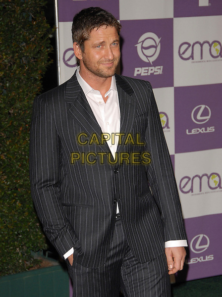 GERARD BUTLER.The 17th Annual Environmental Media Association Awards held at The Ebell Club of L.A. in Los Angeles, California, USA..October 24th, 2007.half length grey gray pinstripe suit jacket hand in pocket stubble facial hair .CAP/DVS.©Debbie VanStory/Capital Pictures