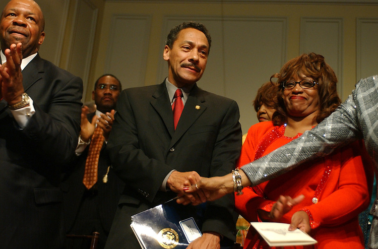 Incoming chairman of the CBC, Mel Watt, D-N.C., gets a round of applause at a Congressional Black Caucus ceremony at the Library of Congress, in which members where sworn into the CBC for the109th Congress,Tuesday.  Outgoing chair, Elijah Cummings, D-Md., is pictured at left, and Rep. Corrine Brown, D-Fla.