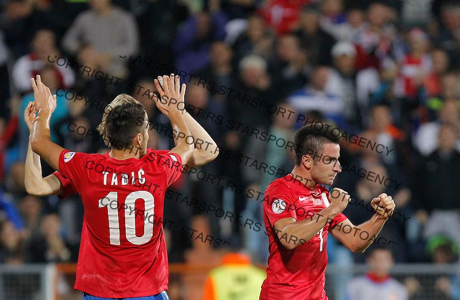 Fudbal Soccer<br /> World Cup 2014 qualifiers match<br /> Serbia v Macedonia<br /> Zoran Tosic (R) celebrates with Dusan Tadic (L)<br /> Jagodina, 15.10.2013.<br /> foto: Srdjan Stevanovic/Starsportphoto &copy;