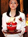 "October 12, 2017, Tokyo, Japan - A hotel clerk displays a Santa Claus shaped Christmas cake ""Santa Claus"" priced 16,000 yen at a press preview for the Prince Hotels chain's Christmas cake collection at the Prince Park Tower hotel  in Tokyo on Thursday, Octoebr 12, 2017. The hotel chain started to accept orders and will deliver before Christmas Day.   (Photo by Yoshio Tsunoda/AFLO) LWX -ytd-"