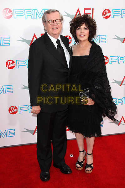 ROBERT DALY & CAROL BAYER SAGER.37th Annual AFI Lifetime Achievement Awards held at Sony Pictures Studios, Culver City, California, USA..June 11th, 2009.full length black dress suit couple clutch bag wrap shawl.CAP/ADM/KB.©Kevan Brooks/AdMedia/Capital Pictures.
