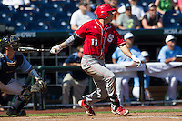 North Carolina State catcher Brett Austin (11) follows through on his swing during Game 3 of the 2013 Men's College World Series between the North Carolina State Wolfpack and North Carolina Tar Heels at TD Ameritrade Park on June 16, 2013 in Omaha, Nebraska. The Wolfpack defeated the Tar Heels 8-1. (Andrew Woolley/Four Seam Images)