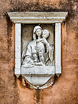 Madonna wall sculpture (frieze), Parish S Martino Vescovo, the colorful village of Burano, Italy.