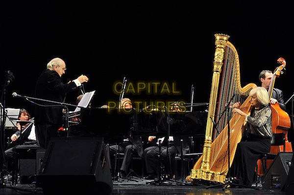 """Michel Legrand, Michel Katrin.Concert in the Hall """"October"""", St. Petersburg, Russia..February 1st, 2012.in concert on stage live gig performance performing music full length black grey gray sheer harp conductor conducting side profile .CAP/PER/VB.©VB/PersonaStars/Capital Pictures."""