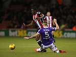 Clayton Donaldson of Sheffield Utd  leaps over Mark Beevers of Bolton Wanderers during the Championship match at Bramall Lane Stadium, Sheffield. Picture date 30th December 2017. Picture credit should read: Simon Bellis/Sportimage