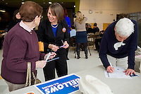 "Shenna Bellows, Democratic candidate in Maine for US Senate, speaks with Shirley Rosen after Bellows spoke to the Portland Democratic City Committee town caucus in the East End School cafeteria in Portland, Maine, USA, on March 3, 2014. Bellows is trying to unseat incumbent Maine Republican Senator Susan Collins in the 2014 election. Rosen, a retired state employee, said, ""After listening to her today, I told her she has my vote. Weneed to get rid of this governor and get more democrats in the Senate."" The town caucus had speeches from various other local candidates and also served to choose delegates for the 2014 Maine State Democratic Caucus."