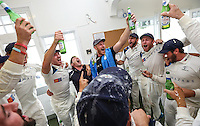 Picture by Alex Whitehead/SWpix.com - 12/09/2014 - Cricket - LV County Championship Div One - Nottinghamshire CCC v Yorkshire CCC, Day 4 - Trent Bridge, Nottingham, England - Yorkshire celebrate winning the County Championship Division One trophy in the dressing room.