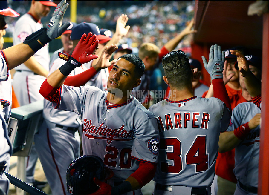 May 12, 2015; Phoenix, AZ, USA; Washington Nationals outfielder Bryce Harper (34) celebrates with teammate Ian Desmond after hitting a solo home run in sixth inning against the Arizona Diamondbacks at Chase Field. Mandatory Credit: Mark J. Rebilas-USA TODAY Sports