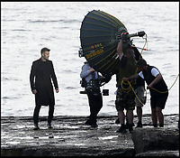 BNPS.co.uk (01202 558833)Pic:   PortlandBirdObservatory/BNPS<br /> <br /> David Beckham lets off some steam as he records a new TV advert for his own skincare product range on a windswept rock.<br /> <br /> The former England footballer was seen filming at the tip of the Isle of Portland in Dorset last night (Tues).<br /> <br /> His production team used canisters of smoke to give the ad more of a wild, atmospheric theme.