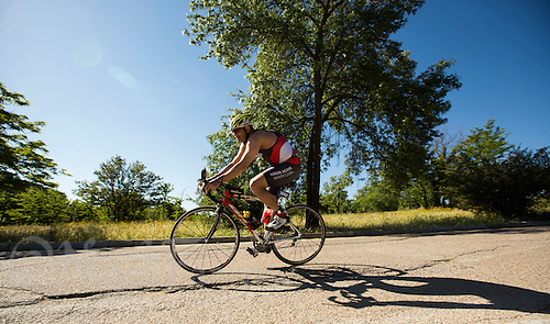 01 JUN 2013 - MADRID, ESP - A competitor makes his  way around the Casa de Campo cycle course in Madrid, Spain during the WTP Agemaster race (PHOTO (C) 2013 NIGEL FARROW)