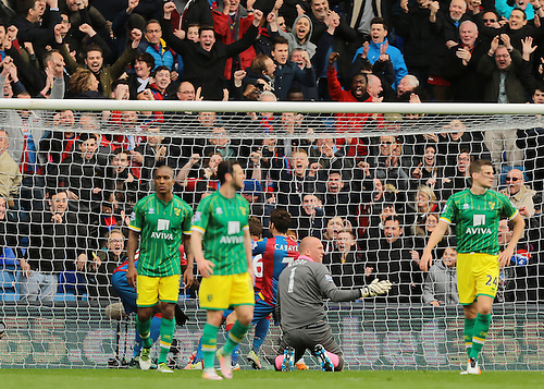 09.04.2016. Selhurst Park, London, England. Barclays Premier League. Crystal Palace versus Norwich. Norwich City Goalkeeper John Ruddy reacts after Crystal Palace's Jason Puncheon slams the ball past him to make it 1-0 Crystal Palace, as Dwight Gayle,  Yohan Cabaye and  Yannick Bolasie celebrate with their fans behind the goal