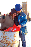 Homeless couple age 43 digging in trash.  St Paul Minnesota USA