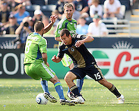 Alejandro Moreno #15 of the Philadelphia Union moves the ball away from Peter Vagenas #8 of the Seattle Sounders FC during the first MLS match at PPL stadium in Chester, PA. on June 27 2010. Union won 3-1.