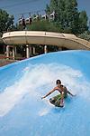 YOung man surfing at an amusement Park, Denver, Colorado, USA