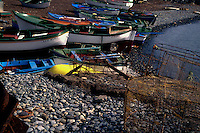 Fishing boats pulled on to stony beach, San Andreas, Terasitas,Tenerife, Canary Islands, Spain