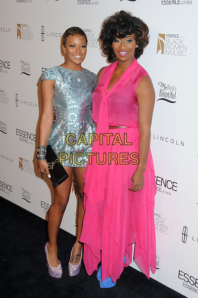 Eva Marcille, Toccara Jones.3rd Annual Essence Black Women In Music Event held at the Belasco Theatre, Los Angeles, California, USA..February 8th, 2012.full length blue print pattern dress elastic elasticated hem shoes pink sheer clutch bag silver black clutch bag.CAP/ADM/BP.©Byron Purvis/AdMedia/Capital Pictures.