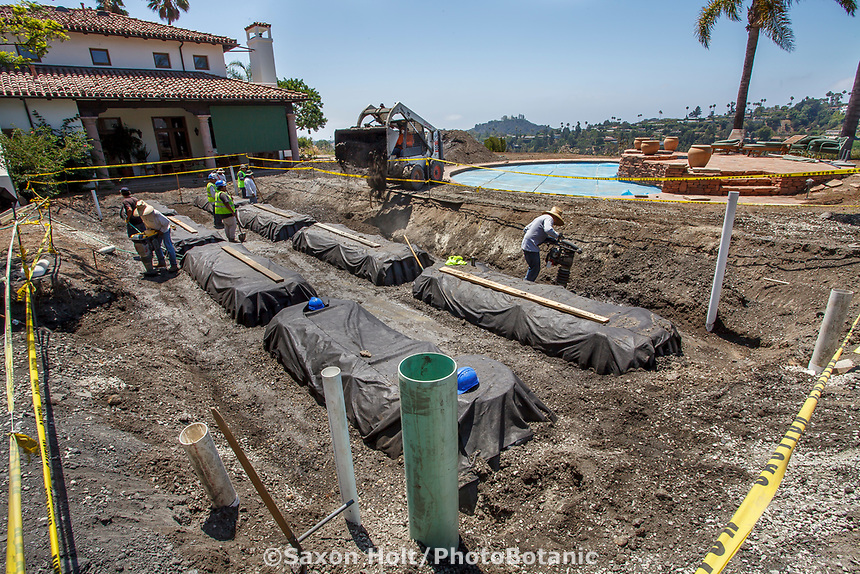 Water capture; workmen installing cisterns in water conserving Southern California garden; design Urban Water Group