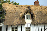 Country cottage being re-thatched, Tattingstone, Suffolk, England