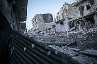 In this Thursday, Nov. 01, 2012 photo, a street destroyed by heavy sheelling and fighting is viewed at the front line in the nearby Karmal Jabl battlefield in Aleppo, the Syrian's largest city. (AP Photo/Narciso Contreras).