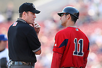April 14, 2010:  Manager Torey Lovullo of the Pawtucket Red Sox discusses a call with umpire Chris Conroy during a game at Coca-Cola Field in Buffalo, New York.  Pawtucket is the Triple-A International League affiliate of the Boston Red Sox.  Photo By Mike Janes/Four Seam Images