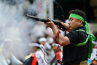 Firing antique weapons at the Somanakamura shrine, Somanomaoi Festival, Minami-soma City, Fukushima Prefecture, Japan, July 26, 2013. During the four-day-long Somanomaoi Festival members of old samurai families ride horseback through the town in traditional armour.  They also take conduct ceremonies at local shrines, take part in horse races, and compete on horseback to catch a flag launched into the air by fireworks.