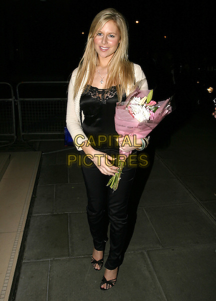 ABI TITMUSS.At the official Pre-Brit Awards 2005 Pool Tournament,.The Garden, Sanderson Hotel, London, .February 8th 2005..full length bunch of flowers bouquet.Ref: AH.www.capitalpictures.com.sales@capitalpictures.com.©Capital Pictures.