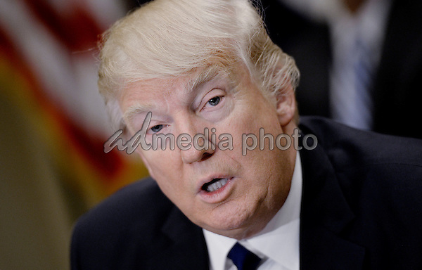 United States President Donald Trump speaks during  a parent-teacher conference listening session in the Roosevelt Room of the White House on February 14, 2017 in Washington, DC. Photo Credit: Olivier Douliery/CNP/AdMedia