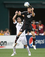 Dejan Jakovic #5 of D.C. United heads the ball away from Fabian Espindola #7 of Real Salt Lake during an MLS match at RFK Stadium, on June 5 2010 in Washington DC. The game ended in a 0-0 tie.