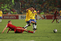 Germany's Sebastian Jung (2) can't stop Brazil's Giuliano (10) during the FIFA Under 20 World Cup Quarter-final match at the Cairo International Stadium in Cairo, Egypt, on October 10, 2009. Germany lost 2-1 in overtime play.