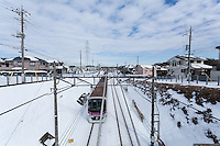 A commuter train on a snow covered line in Tsukushino, Tokyo, Japan Sunday February 9th 2014. The heavy snows hit Japan in the winter of 2014.