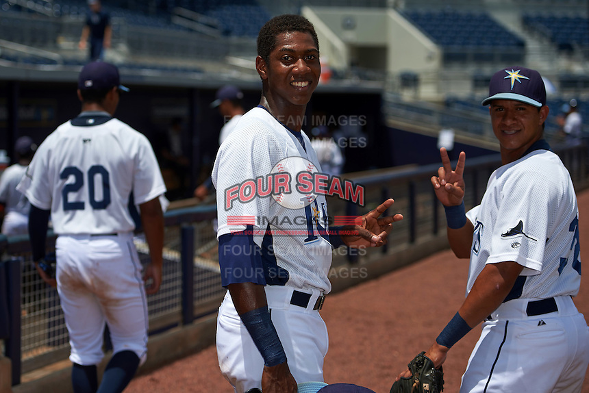 GCL Rays Miguel Hernandez (14) and Anthony Cantillo (38) before the second game of a doubleheader against the GCL Red Sox on August 4, 2015 at Charlotte Sports Park in Port Charlotte, Florida.  GCL Red Sox defeated the GCL Rays 2-1.  (Mike Janes/Four Seam Images)