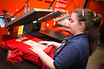 © Joel Goodman - 07973 332324 . 27/01/2014 . Manchester , UK . United Megastore employee AMY ANNING (22, from Stalybridge) prints up new shirts with MATA 8 for customers inside the store . Fans with new MATA 8 shirts in front of Old Trafford Football Ground as it's announced that Spaniard Juan Mata ( Juan Manuel Mata García ) has signed for Manchester United  . Photo credit : Joel Goodman
