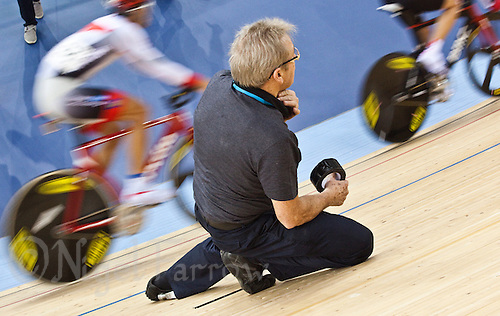 17 FEB 2012 - LONDON, GBR - An event management team member repairs a section of track damaged in a crash during the Men's Omnium qualifiers at the UCI Track Cycling World Cup and London Prepares test event for the 2012 Olympic Games at the Olympic Park Velodrome in Stratford, London, Great Britain .(PHOTO (C) 2012 NIGEL FARROW)