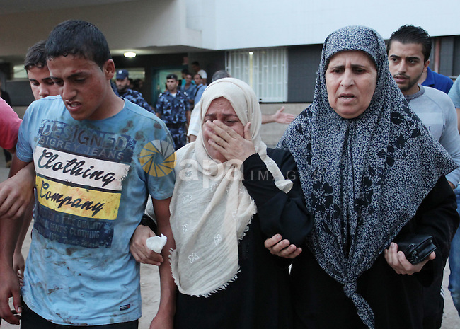 Relatives of Palestinians, who were wounded during clashes with Israeli security forces near the border fence between Israel and the Gaza Strip, arrive at al-Shifa hospital in Gaza city on October 9, 2015. Tension and protests rose after an Israeli man on 09 October stabbed four Palestinians in southern Israel, in what is being seen as a revenge attack, officials said. On 08 October several violent incidents happened, including stabbings which left eight Israelis injured, one Palestinian was killed in East Jerusalem and six in the Gaza Strip in clashes with the army while at least six were injured on the West Bank. Photo by Ashraf Amra