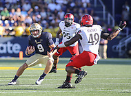 Annapolis, MD - September 23, 2017: Navy Midshipmen quarterback Zach Abey (9) tries to avoid a tackle during the game between Cincinnati and Navy at  Navy-Marine Corps Memorial Stadium in Annapolis, MD.   (Photo by Elliott Brown/Media Images International)
