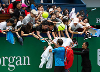 SHANGHAI - OCTOBER 6: Roger Federer of Switzerland signs autographs after practice before the start of the Rolex Shanghai Masters at Qi Zhong Tennis Centre on October 6, 2018 in Shanghai, China