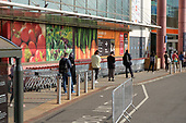 Queue outside a branch of Sainsburys, Finchley Road, London, during the Covid-19 pandemic.