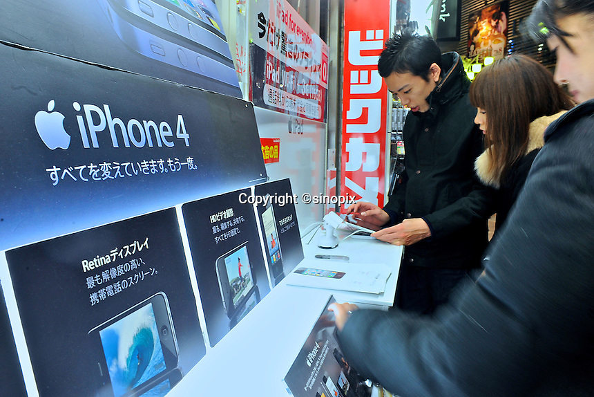 Customers look at the iphone 4G in a shopping mall in Tokyo, Japan. Softbank have the exclusive license for Apple's iPhone in Japan. From Bloomberg's 2010 report, iPhone is the top selling smartphone in Japan and is dominating the market with a 72% share, its biggest comptitors in Japan are HTC, which holds 11% of the smartphone market share, and Toshiba with a 6.8% market share. .