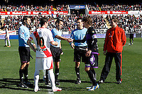 Rayo Vallecano's Piti, referee Pedro Jesus Perez Montero and Marc Valiente during La Liga  match. February 24,2013.(ALTERPHOTOS/Alconada)